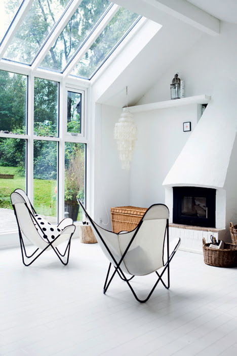 Clean black and white butterflies in a Danish summer cottage - via Coco Lapine
