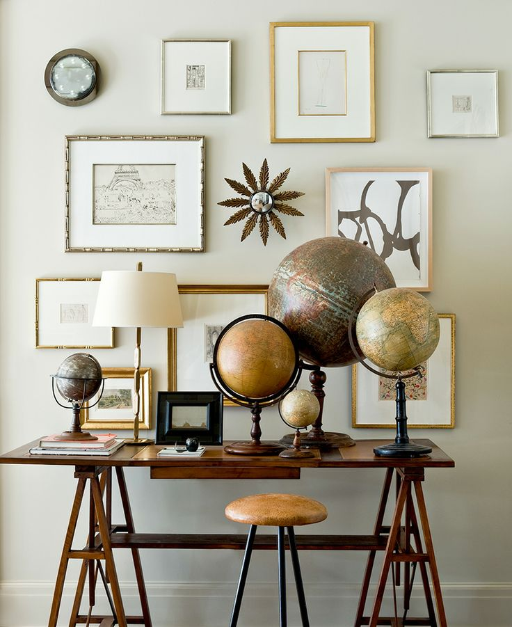 A collection of antique globes, thrown together by interior designer Suzanne Kasler - via Pinterest