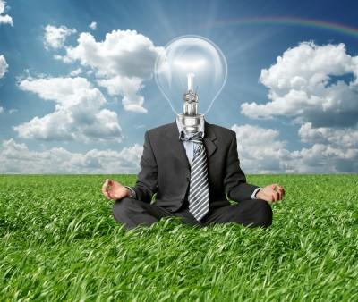inspiration-meditating-businessman-lightbulb