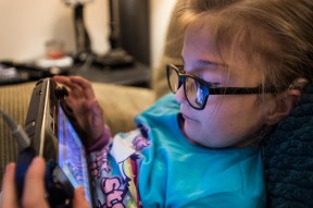 Emmeline Harris, 8, plays video games on Wednesday Jan. 25, 2017 in Sweet Briar, Va. Because Emmeline was born with out semicircular ear canals to help her balance she likes to play video games because she can play them while sitting or lying down.