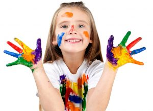 Inner artist - girl with paint all over hands, face and tshirt