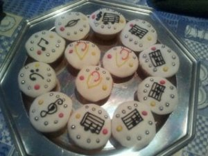 A plate of cookies with iced treble clefs and music