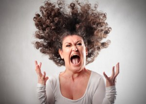 How to sound uncomfortable, comfortably - funny photo of a woman screaming with her hair on end