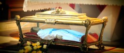 The glass Casket. Her skeletal remains are enclosed in the wax statue