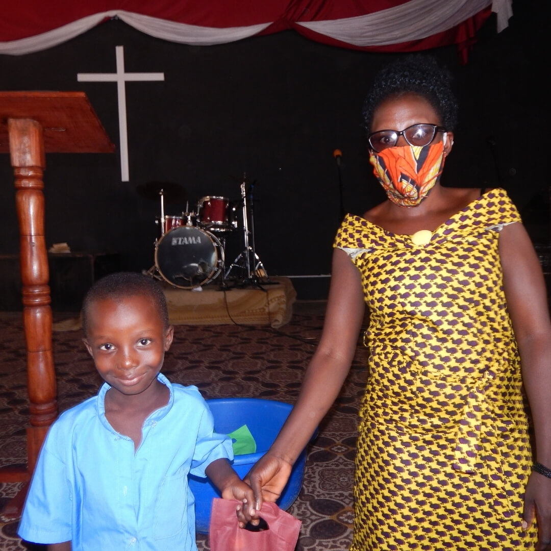teacher giving bwiza student gift