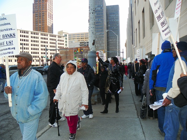 Marchers pack sidewalks outside federal courthouse in Detroit April 1, 2014.