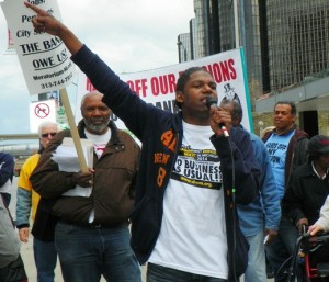 Demeeko Williams points to CAYMC -- That building belongs to us!