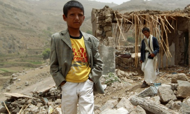 A Yemeni boy stands in front of a damaged house in the village of Bani Matar, a day after it was reportedly hit by an airstrike by the Saudi-led coalition against Shiite Huthi rebel positions. Photograph: Mohammed Huwais/AFP/Getty Images