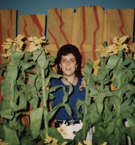 a much younger me peeking through the corn