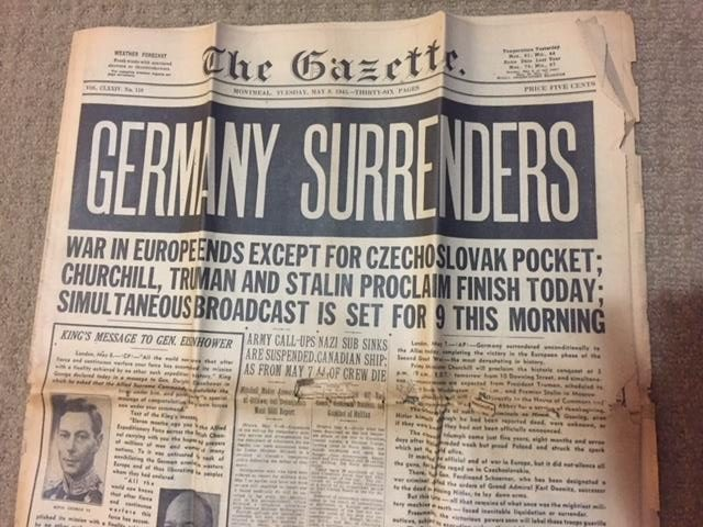 Headline of the Montreal Gazette reads Germany Surrenders, dated May 8, 1945