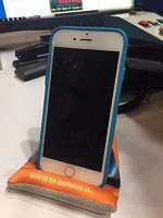 iPhone sitting on a stand