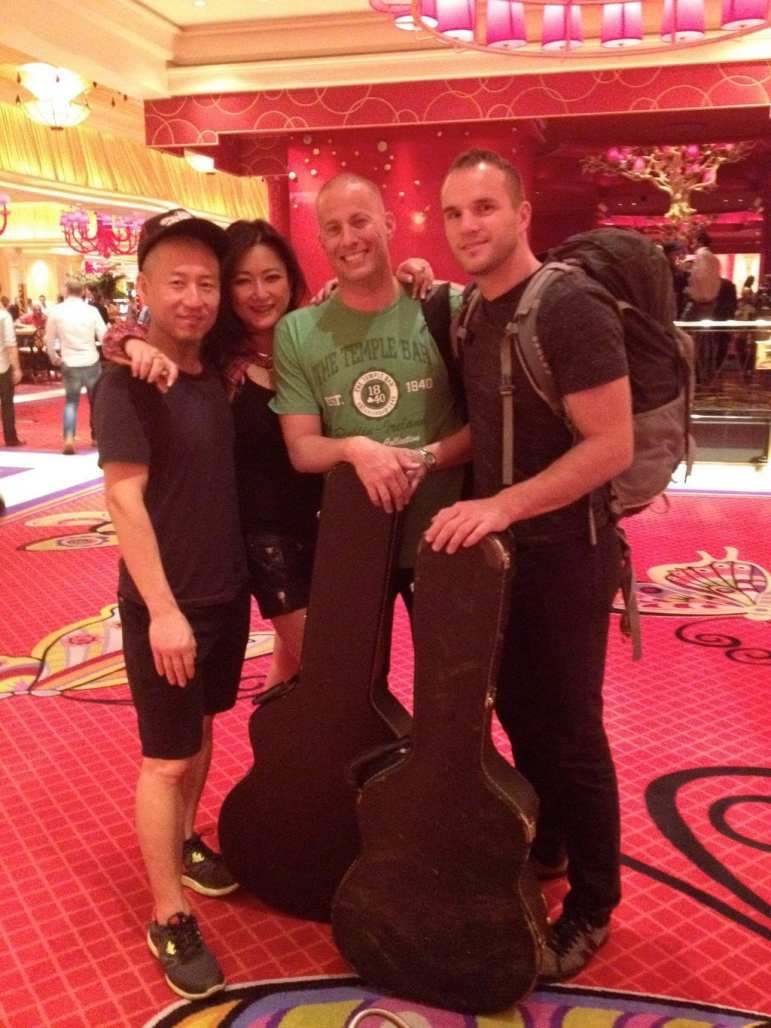 Andy Hong, left, Susan Kang Schroeder, a band member and Scott Foster in Las Vegas.