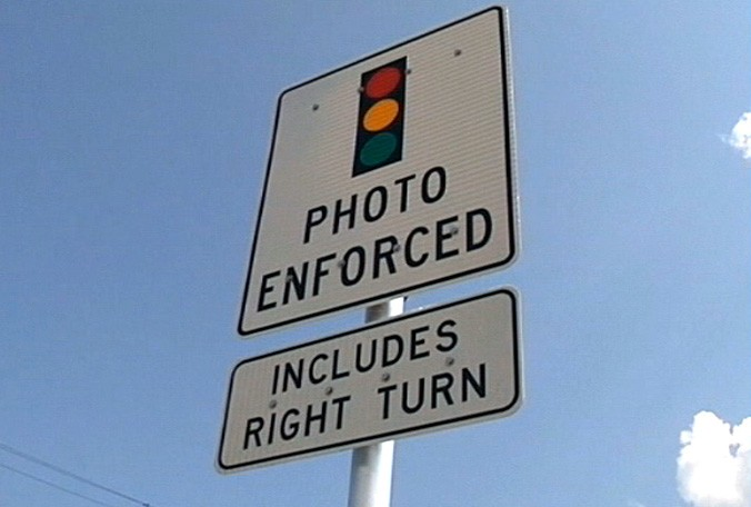 A warning sign for a red light camera system. Garden Grove officials are considering banning them. (Photp  credit: unknown)