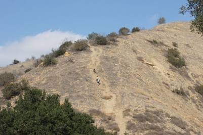 Hikers climbing up a social trail at the Telegraph Canyon / Easy Street Juncture.
