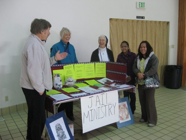 Sr. Racko, center, with volunteers at a recent ministry fair.