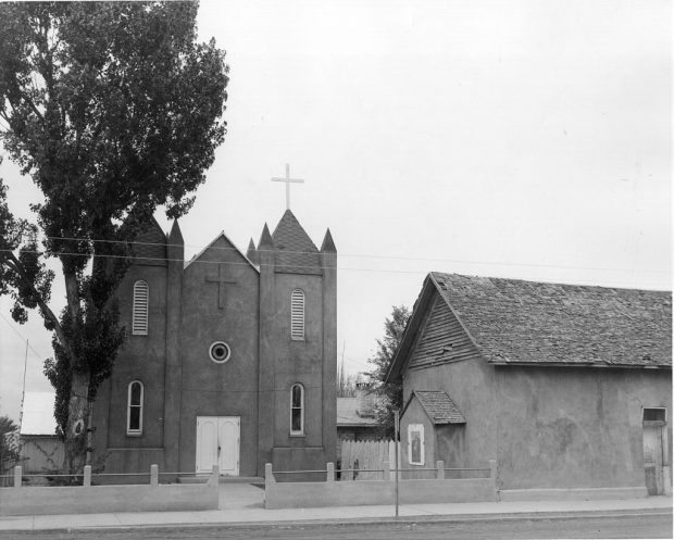 The new church, left, is shown shortly after it was built, standing beside the old church, right. The church was built in the late 1930s and dedicated by Bishop Bernard Espelage, OFM, in the early 1940s. The old church stood until the 1970s and served for many years as the parish hall.