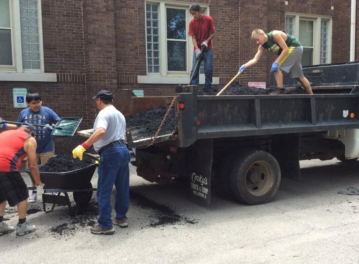 Shoveling mulch.