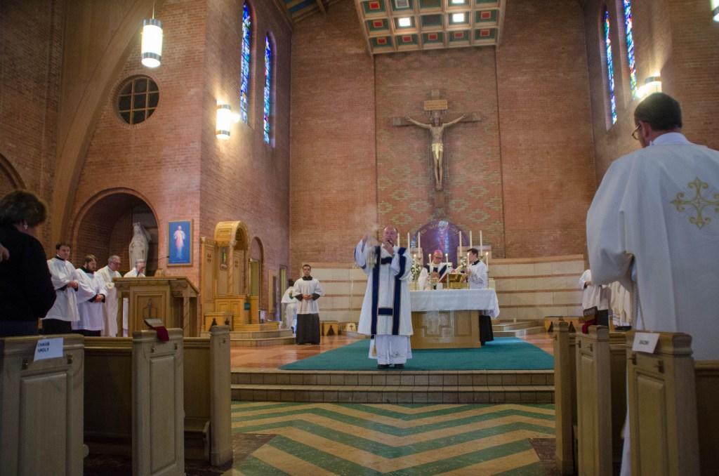 Cormack, now a deacon, blesses the congregation.