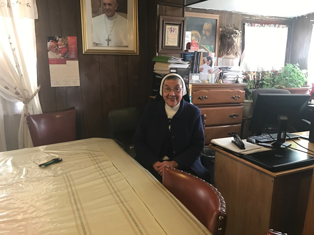 Mother Magda, in the room that serves as both an eating area and an office.