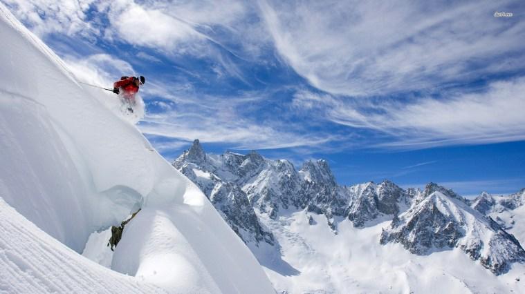 Skier descending mountain, near Chamonix-Mont-Blanc, France