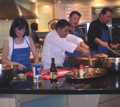 Adalberto Diaz makes his weekly cooking class a hands-on experience for students. Photo by David Servatius.