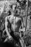 A young Maori man dancing