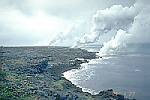 White acid-rich steam plume rises from lava flows entering the sea