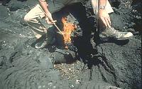 Burning torch on end of stick, Nyamuragira Volcano, Zaire