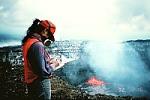 Geologist with gas mask on rim of Pu`u `O`o crater, Kilauea Volcano, Hawai`i