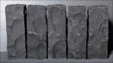 Aphanitic texture: rapid cooling, a uniform, fine grained rock. Image: Quarried basalt.