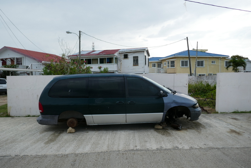 Car without wheels in Belize City.