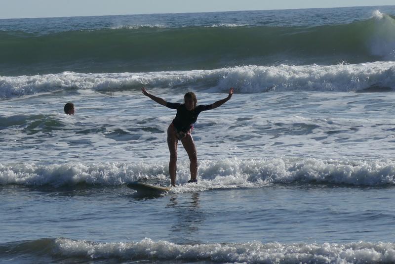 Anete surfing a baby wave at San Blas, near El Tunco.