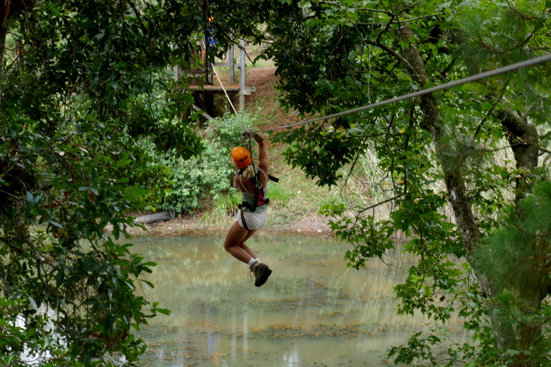 Anete on a zip line at Chicoj Coffee Tour, near Cobán, Guatemala.