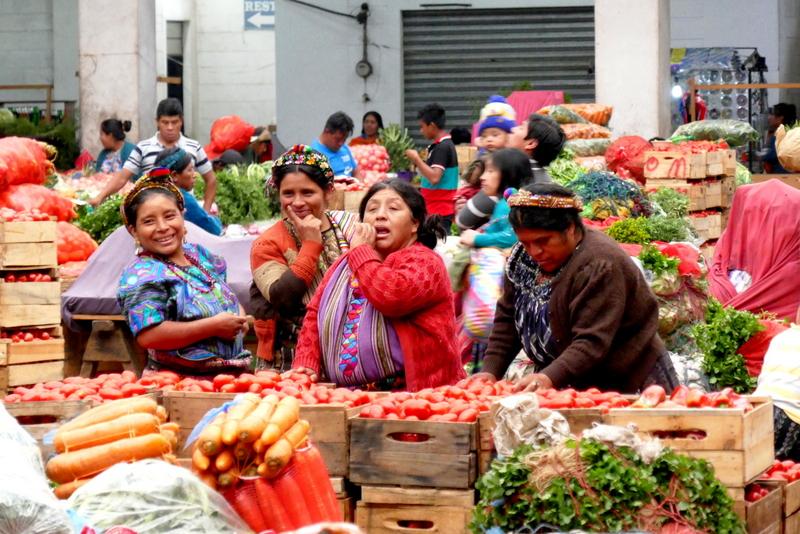 Mayan ladies in vegetable market in Zunil, near Xela.