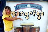 Anete drumming on Garifuna drums on mural in Dangriga, Belize.