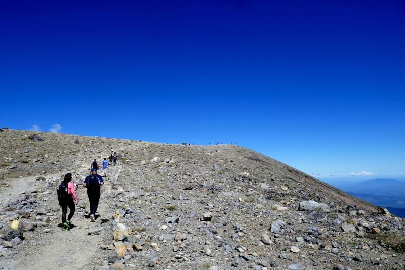People climbing volcano santa Ana