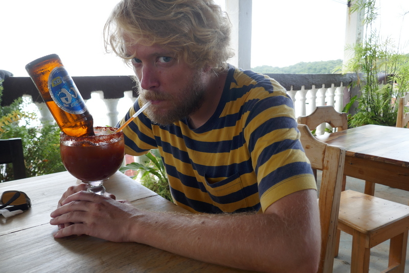 Tom drinks michelada in Flores.