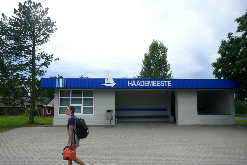 Coastal hiking in Estonia: Anete walks past the bus station in Häädemeeste