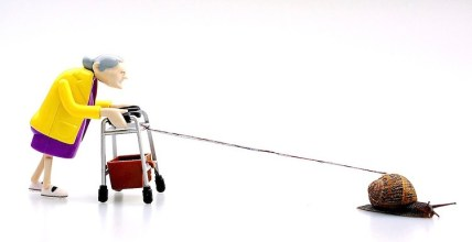 Old Lady with Zimmer Frame towed by snail