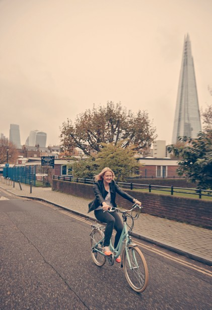 Woman on e-bike with Shard in the background