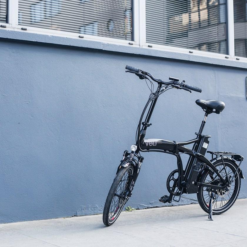 Black VOLT Metro e-bike parked on the pavement