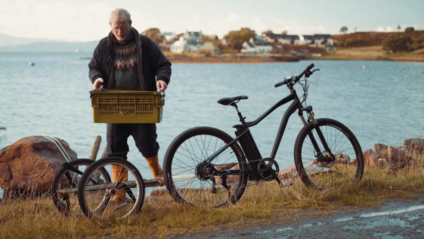 Scottish fisherman Ali Macleod carrying his catch using his VOLT Alpine e-bike