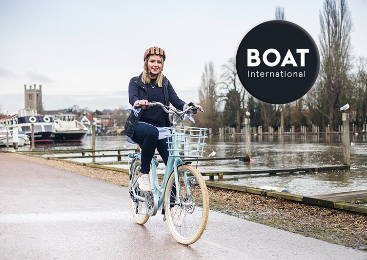 A cyclist rides her VOLT Kensington e-bike along the canal