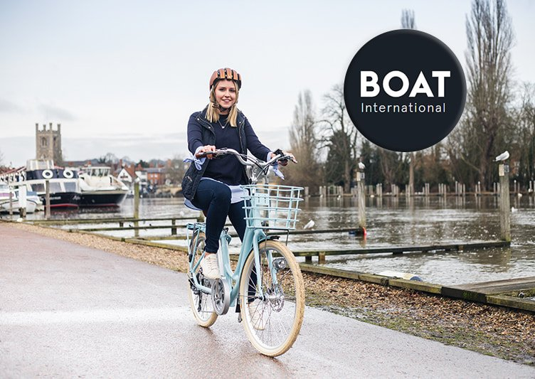 A cyclist rides her VOLT Kensington e-bike along the canal