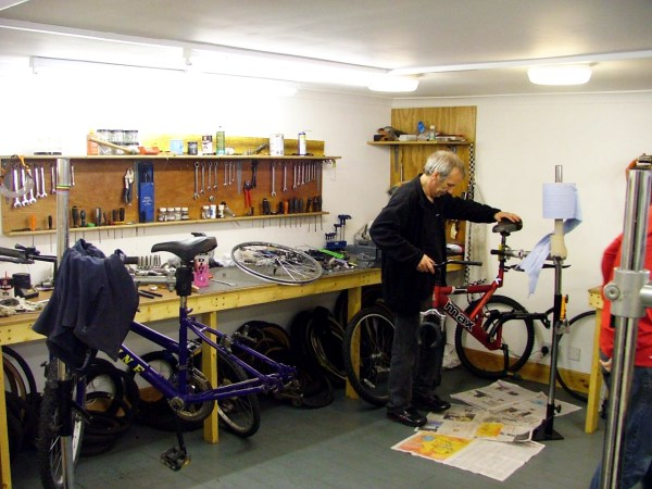 A Shetland Community Bike Project staff member services a bike