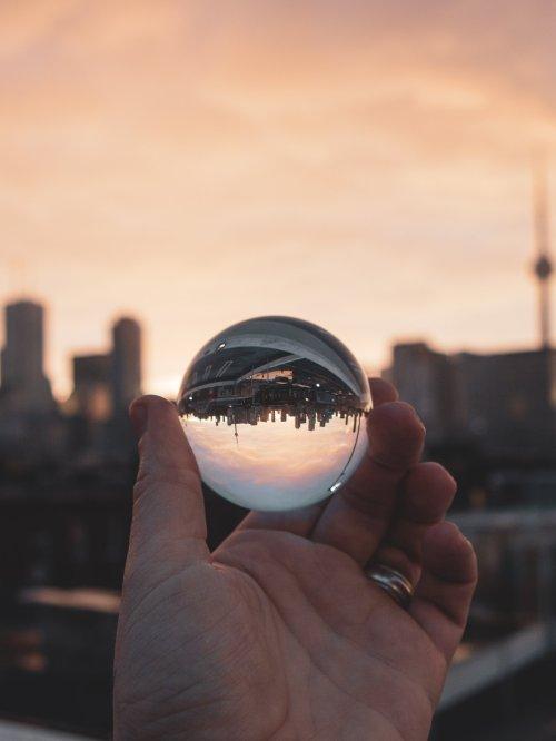 city through glass ball by thom bradle