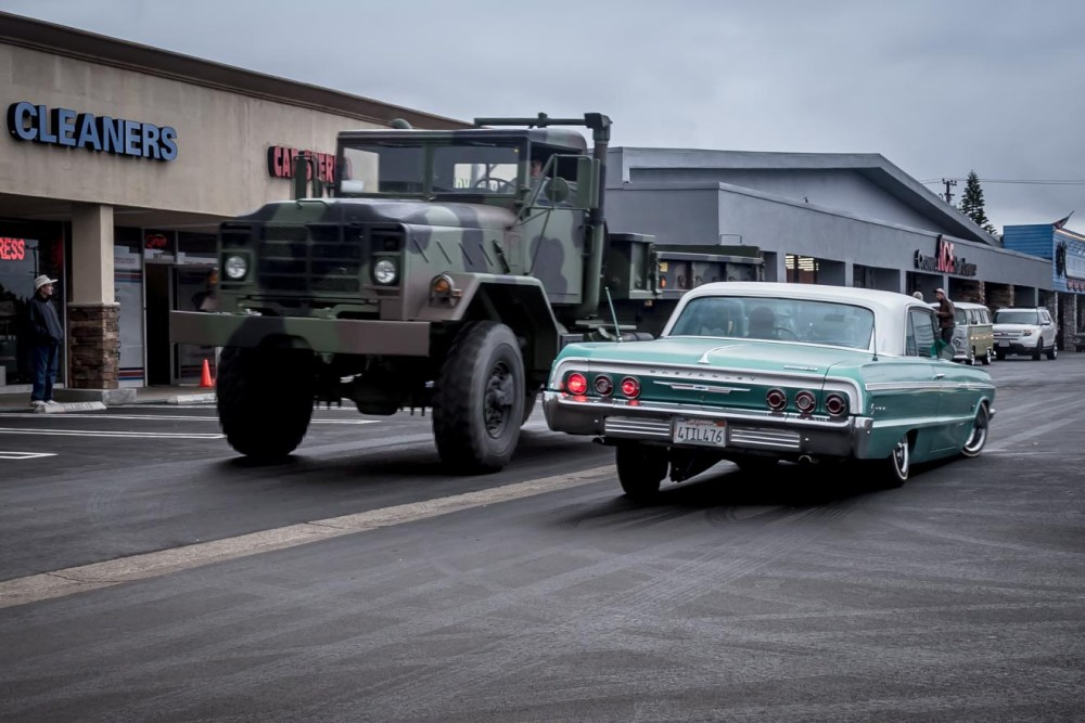 Military truck and Chevy Impala