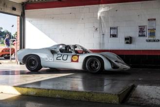 Porsche 910 parked in the pit garage