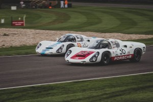 Two Porsche 910's racing at Goodwood