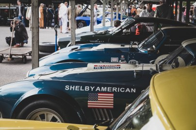 American race cars in the Goodwood paddock.
